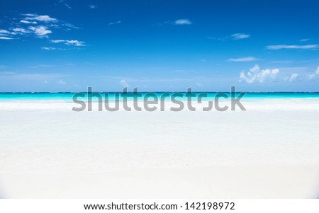 Beautiful seascape, clean white sandy beach, blue sky, turquoise peaceful sea, luxury tropical resort, romantic honeymoon, summer holiday concept - stock photo