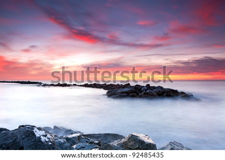 Beautiful seascape . Colorful sunrise over the sea under a dramatic sky. Nature composition.