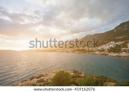 Beautiful seascape: resort town on a rocky beach by the sea - stock photo