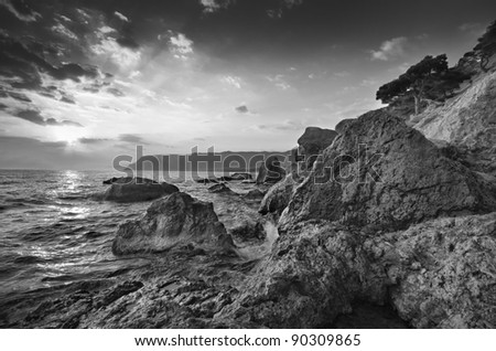 Beautiful seascape. Sea and rock at the sunset. - stock photo