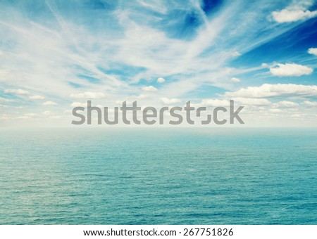beautiful seascape with deep  ocean  waters and cloudscape at early morning - stock photo