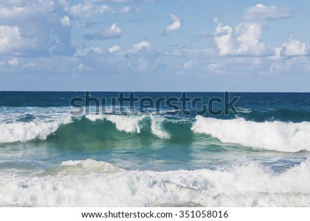 Beautiful seascape with emerald waves - stock photo