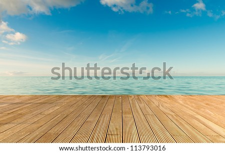Beautiful seascape with empty wooden pier giving a warm relaxing feeling - stock photo