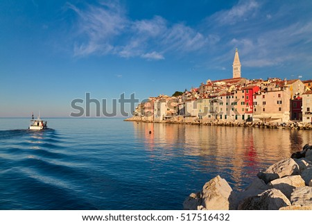 Beautiful seascape with small fishing boat and old town of Rovinj, Istria, Croatia.