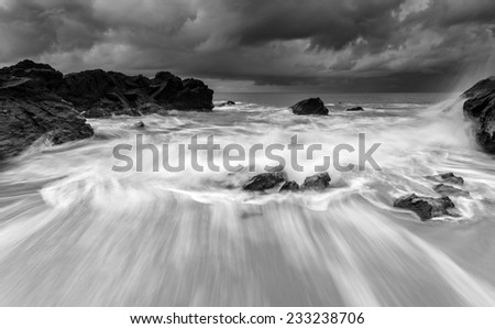 Beautiful seascape with the monsoon rage.  A little noise grainy texture. - stock photo