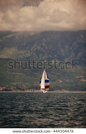 Beautiful Seascape with White Yacht Sailing in Blue Sea