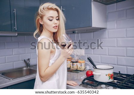 Attractive Girl Cooking On Her Kitchen Stock Photo 530457229 ...