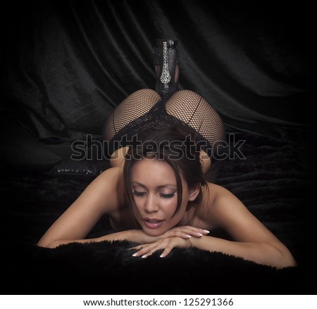 Beautiful seductive young exotic slim brunette model actress posing as burlesque style dancer - stock photo