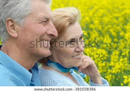 Beautiful senior couple  in a summer field - stock photo