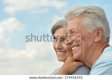 Beautiful senior couple on the background of sky