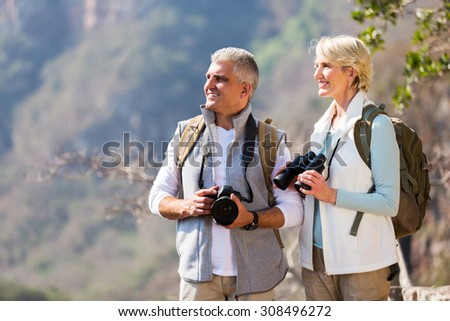 beautiful senior hikers enjoying outdoor activity - stock photo
