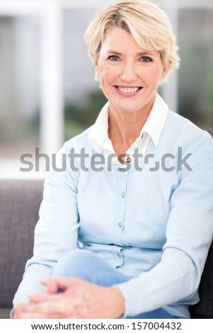 beautiful senior woman sitting at home - stock photo