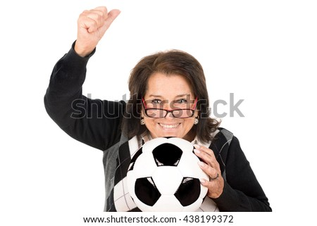 Beautiful senior woman with soccer ball isolated in white - stock photo