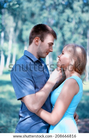 Beautiful sensual couple in love, kiss moment - stock photo