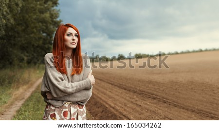 Beautiful sensual girl in a lonely field