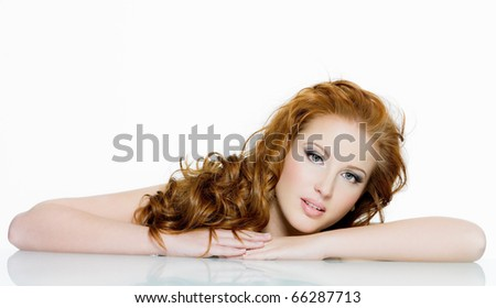 Beautiful sensual red-haired woman with long  wavy hairs - isolated on white - stock photo