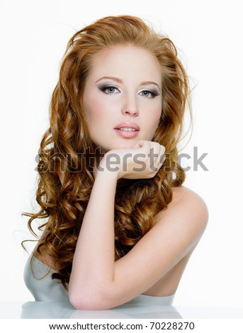 Beautiful sensual red-haired woman with long  wavy hairs - isolated on white