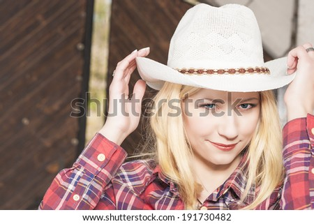 Beautiful Sensual Smiling Happy Blond Cowgirl on Farm. Horizontal Image - stock photo