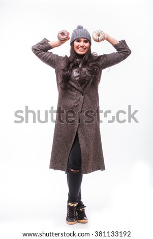Beautiful sensual woman having fun with donuts full height on white background. Series of photos. - stock photo