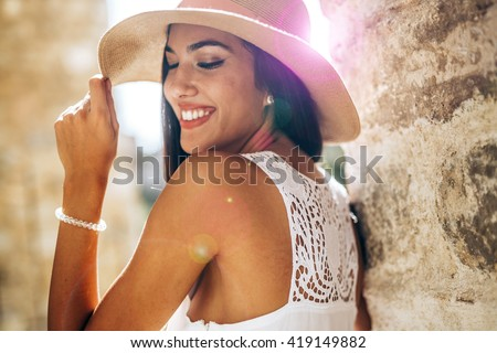 Beautiful sensual woman in hat being truly happy and positive - stock photo