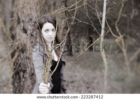 beautiful sensual woman in wood harmony with nature