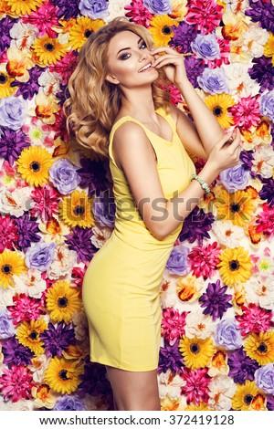 Beautiful sensual woman yellow dress bracelet stock photo royalty beautiful sensual woman in yellow dress and bracelet on colorful wall of flowers fashion photo mightylinksfo