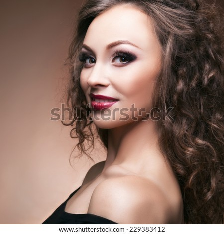 Beautiful sensual woman on brown background. Toned and clean skin. Fashion, glamour and beauty usage. Professional make up - stock photo