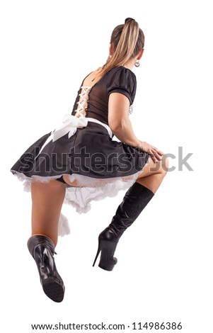 Beautiful sensual woman posing in a skimpy maids uniform with miniskirt on a white background