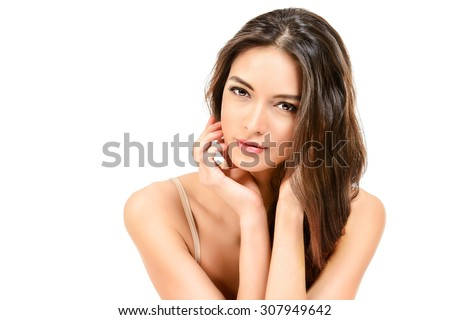 Beautiful sensual woman touching her face. Beauty and skincare concept. Spa. Isolated over white.  - stock photo