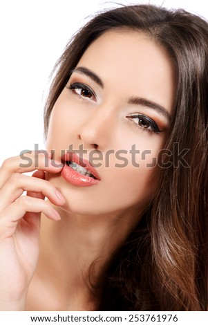 Beautiful sensual woman touching her lips. Beauty and skincare concept. Spa. Isolated over white.