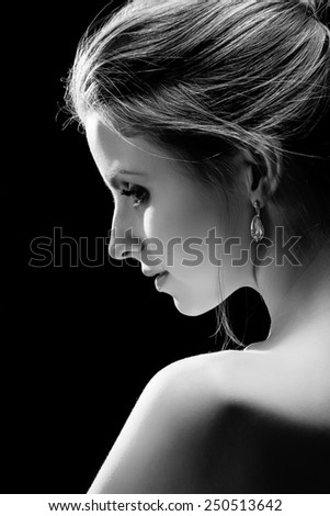 beautiful sensual woman with bare shoulder, monochrome image