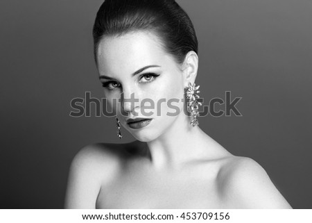 Beautiful sensual woman with elegant hairstyle.Beauty wedding hairstyle. Bride. Wedding accessories. Black and white photo.