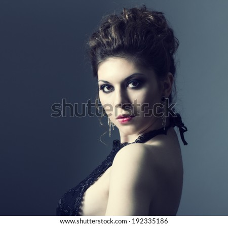 beautiful sensual woman with elegant hairstyle. Perfect makeup. Fashion photo