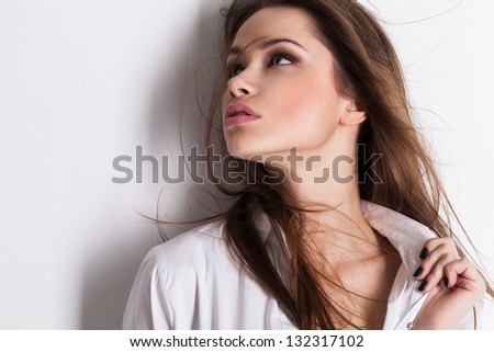 Beautiful sensual young woman in men's shirt on a white background - stock photo