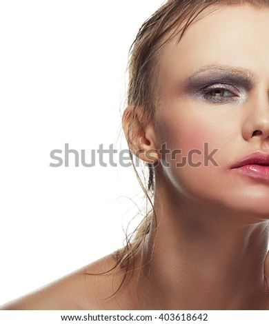 Beautiful sensuality elegance caucasian lady face woman, green eyes, blonde hair, sexy lips, finger near kissed effect lips. Studio portrait.  - stock photo
