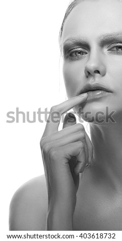 Beautiful sensuality elegance caucasian lady face woman, green eyes, blonde hair, sexy lips, finger near kissed effect lips. Studio portrait.  - stock photo