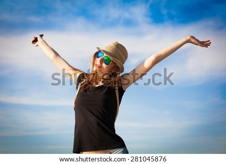 beautiful sensuality elegance lady haired woman happy fun cheerful smiling blue sunglasses black t-shirt hat urban city portrait nature slim sport body space impressions - stock photo