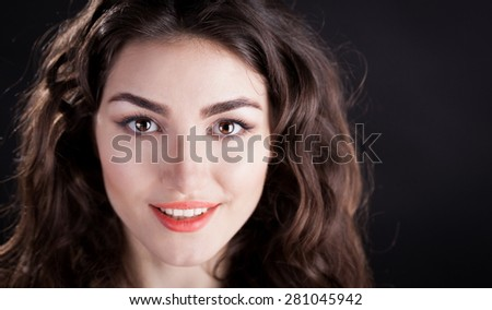 beautiful sensuality elegance lady smiling joy fun woman face brown eyes studio portrait professional light nature romantic wellness pure gloss hair brunette white teeth black  background - stock photo