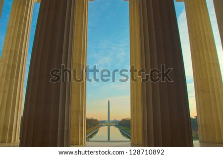 Beautiful serene dawn reflects Washington Monument in the new Reflecting Pool. Framed by pillars from the Lincoln Memorial. Washington, DC - stock photo