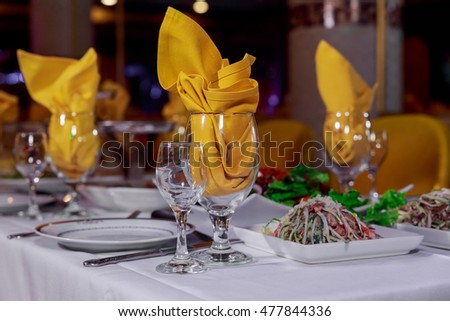 Beautiful served table for wedding or other celebration in restaurant table decorated for celebration