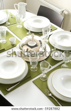 beautiful served table with green napkins - stock photo