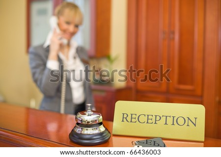 Beautiful service business woman with reception desk.