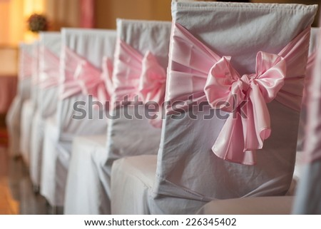 Beautiful setting ready for a indoor wedding reception. - stock photo