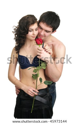 Beautiful sexual couple with red rose isolated over white background - stock photo