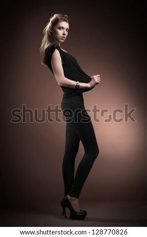 Beautiful sexual girl model pose on brown background