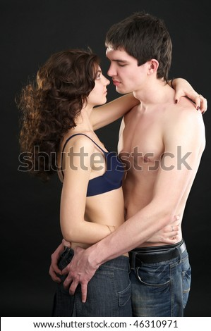 Beautiful sexual half naked couple over black