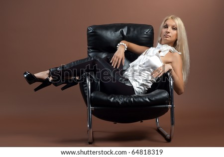 Beautiful sexual high-heeled girl on brown background