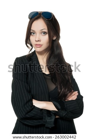 Beautiful sexy brunette girl in a black dress and jacket posing on a white background isolated - stock photo
