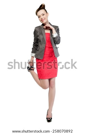 Beautiful sexy brunette girl in a red dress and jacket on a white background isolated