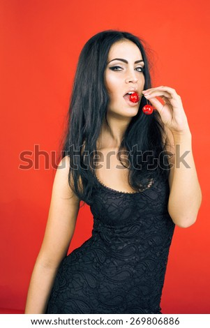 beautiful sexy brunette woman on red background - stock photo